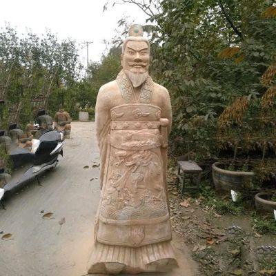 秦始皇晚霞红石雕像