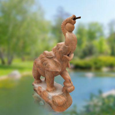 喷水小象晚霞红石雕